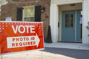 """""""Photo ID required to vote"""" sign"""